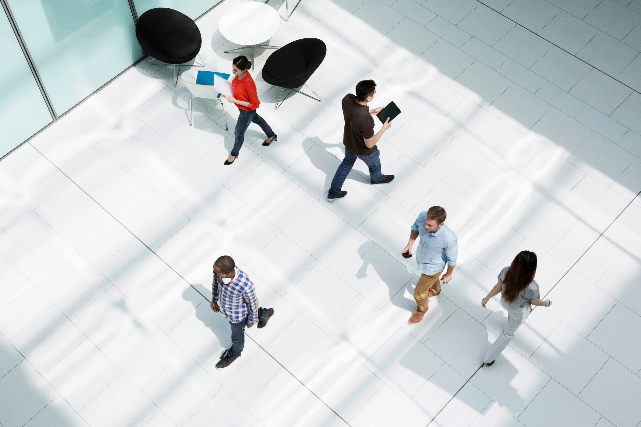 People walking on office concourse